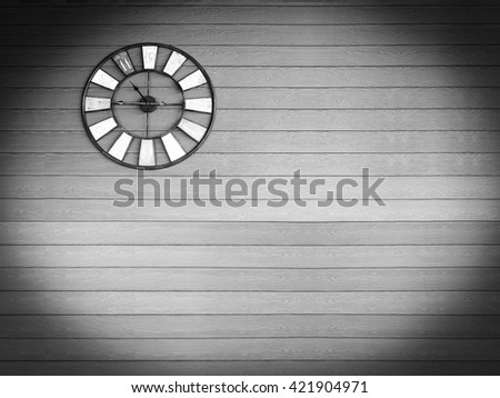Old vintage black and white color clock on wooden plank wall background. - stock photo