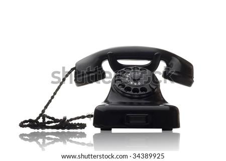 old vintage black rotary telephone isolated on white - stock photo