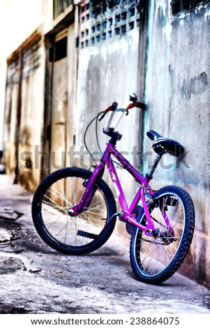 Old vintage bmx bike on the street  bicycle near the concrete wall. - stock photo