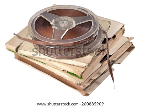 Old vintage bobbins with magnetic tapes on a white background - stock photo