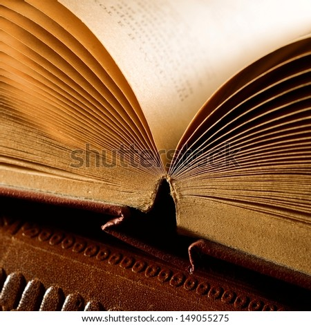Old vintage book close-up  in dramatic light - stock photo