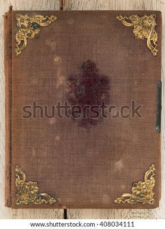 Old vintage book cover with golden ornaments - stock photo