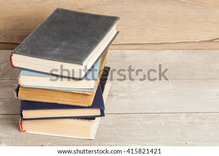 Old vintage books on a wooden table  - stock photo