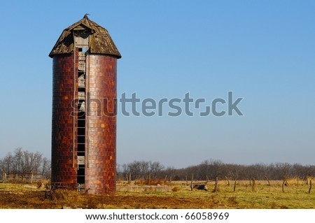 Old vintage brick silo in a field with copy space - stock photo