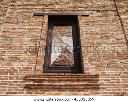 old vintage brick wall with window - stock photo