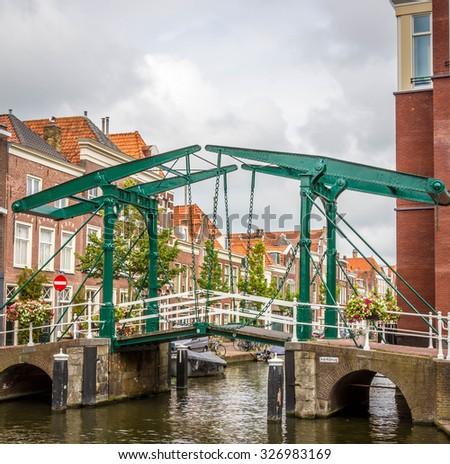 Old vintage bridge in Leiden, Holland - stock photo