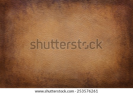 Old vintage brown leather texture closeup can be used as background - stock photo