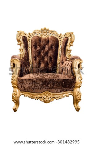 Old vintage brown velvet classic armchair with gold color isolated on white background - stock photo
