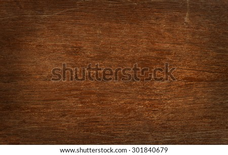 Old vintage brown wooden faded aged flat board with cracks, checks, other defects and shaded border