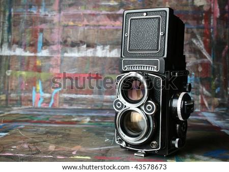 old vintage camera in artist's studio - stock photo