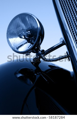 old vintage car chromium-plated headlight close up, monochromatic - stock photo