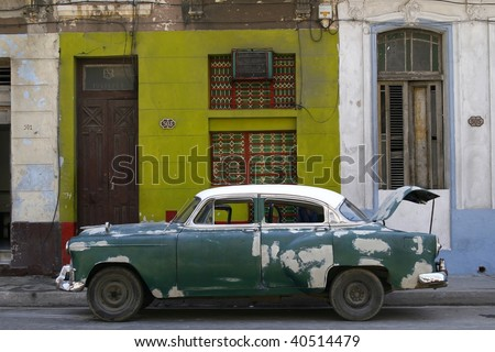 Old vintage car on the street with visible sign of attempts of clumsy repair work with white paint. Havana, Cuba