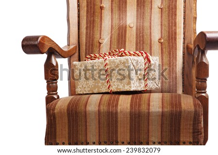Old vintage chair with sealed Christmas present - stock photo