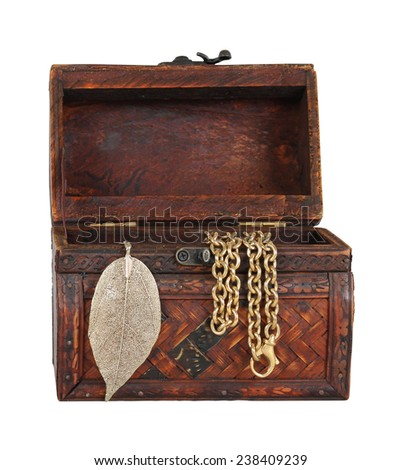Old vintage chest with open lid and gold jewelry hanging out isolated with clipping path included