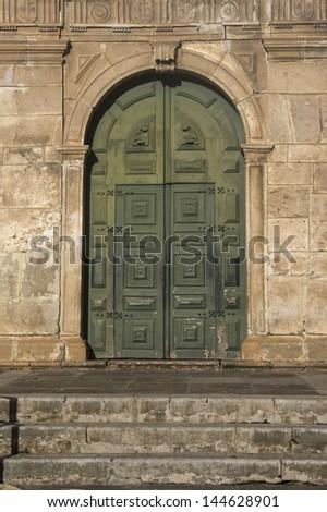 Old vintage church wooden green door. - stock photo