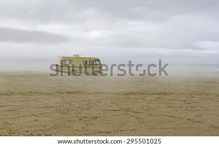 old vintage class A motorhome on the sand beach near Astoria Oregon - stock photo