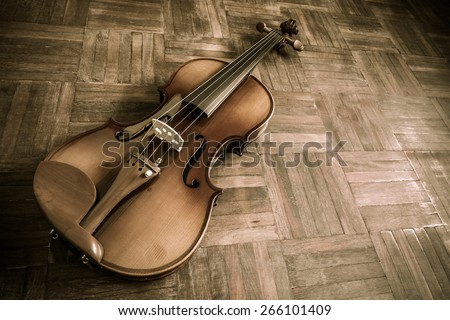 old vintage classical violin on wooden floor background for music concept - stock photo