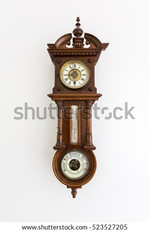 Old vintage clock with barometer and thermometer isolated on white wall
