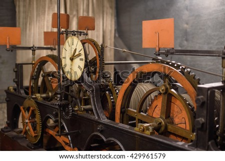 Old vintage clock with wheels and castors close up - stock photo
