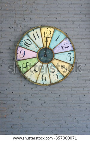 Old Vintage Colorful Clock on isolated on a brick wall, selective focus - stock photo