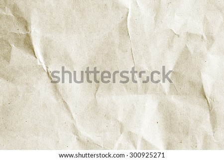 old vintage crumpled cream color tone paper pattern texture background in sepia light.bright:tan creased plain flat backdrop concept.grunge disheveled wallpaper.empty edge parchment paper sheet wall. - stock photo