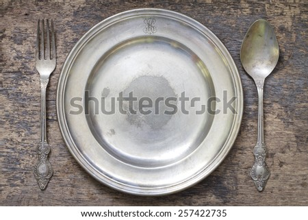 Old vintage cutlery and dishware abstract food background - stock photo