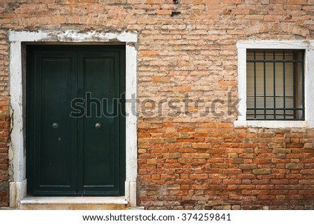 Old vintage door, window and wall in Venice, Italy.