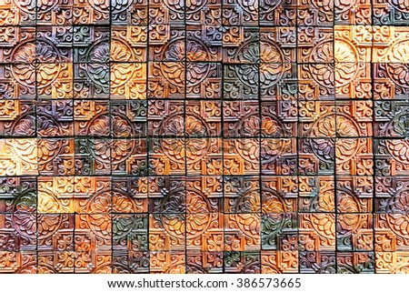 Old vintage earthenware wall  tiles patterns handcraft from thailand public. - stock photo