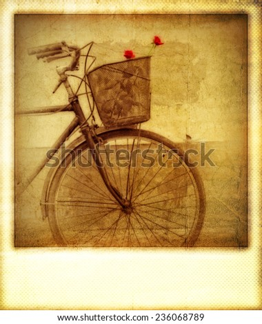Old vintage effect instant photo of red roses in bicycle basket - stock photo