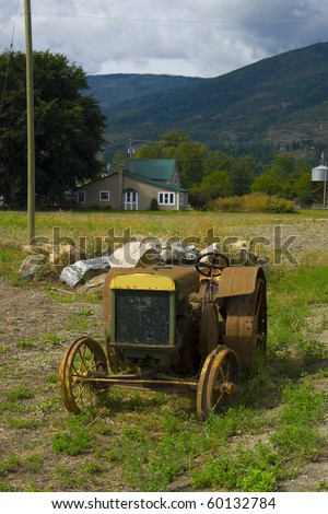 Old Vintage Farm Tractor left abandoned in a small town