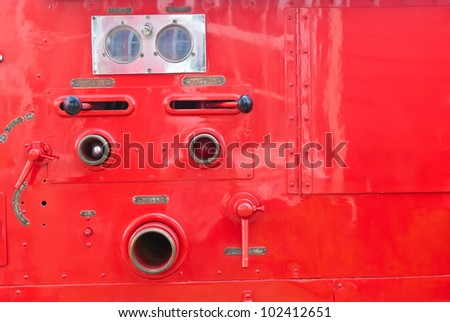 Old vintage fire engine detail at a Fire and emergency services week in Bangkok - stock photo