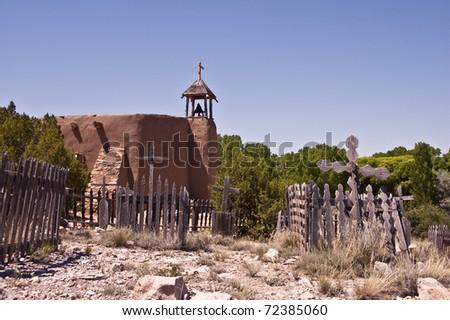 Old Vintage graveyard near the village church at Rancho Los Golondrinas just outside of Santa Fe, New Mexico. - stock photo
