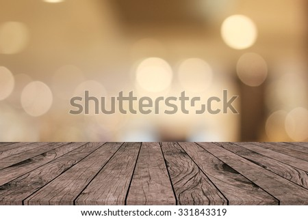 old vintage grungy red brown wood tabletop with blurred warm light colored backgrounds:grunge aged surface wooden with blurry warm cream light bokeh backdrop.put and show your products on this display - stock photo
