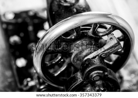 Old vintage hand sewing machine. Selective focus.Black & white image - stock photo
