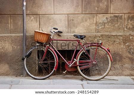 Old vintage Italian bicycle with big basket - stock photo