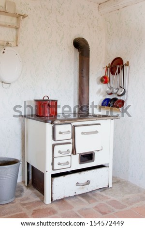 Old vintage kitchen in shabby chic style with an old wood-burning oven