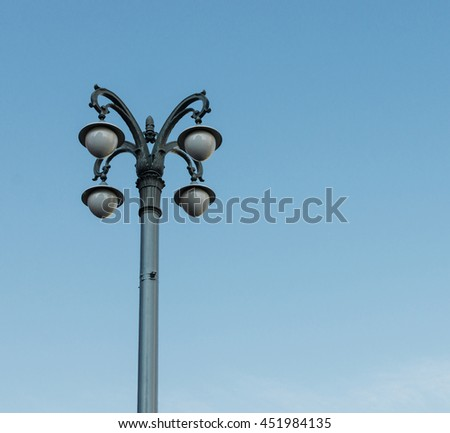 Old vintage lamp-post in moscow on the blue sky background - stock photo