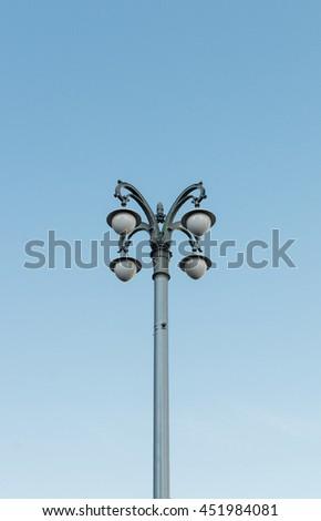 Old vintage lamp post on blue sky backround  - stock photo