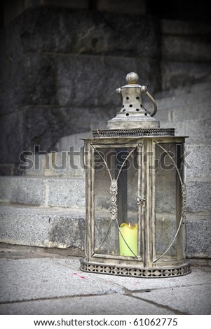 Old vintage lamp with candle inside