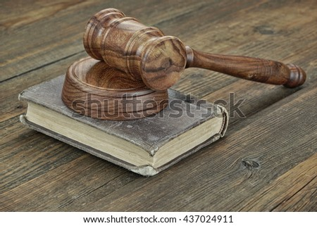 Old Vintage Law Book And Judges Gavel Or Hummer On Top On The Wooden Table In Law Office Or Courtroom, Law Education Concept, Close Up - stock photo