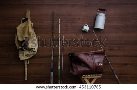 old vintage leather bag on old wooden floor with leather background - stock photo