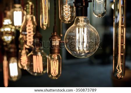Old vintage light bulb - stock photo