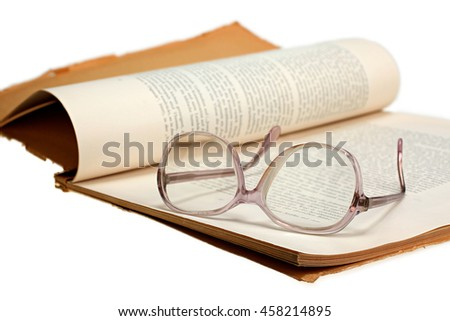 Old vintage magazine and glasses isolated on white background with clipping path - stock photo