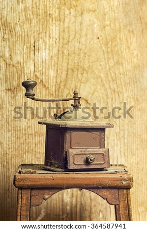 old vintage manual coffee grinder on wooden background  - stock photo