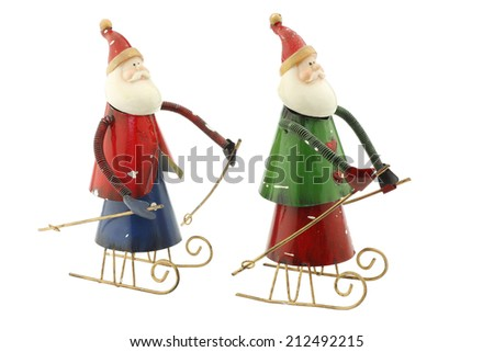 Old vintage metal Santa Claus figures on a sleigh usable for christmas greeting cards - stock photo