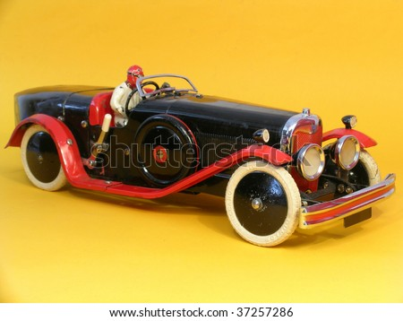 Old vintage metal toy car - stock photo