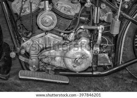 Old vintage motorcycle engine 20th century The old motor the motor of the motorcycle (black and white photo)  - stock photo