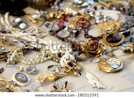 old vintage necklaces and jewelry for sale in the antique shop - stock photo