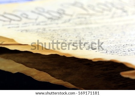 Old vintage paper - Side view closeup - stock photo