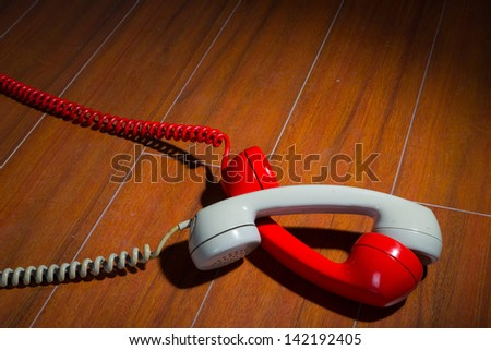 Old vintage phone handsets on wood - stock photo
